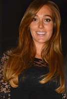Jacqui Ainsley wearing the Amelia Dress Short (Black)