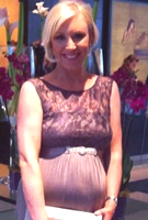 Mel Barnham wearing the Valencia Gown Long (Charcoal)