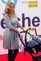 Jasmine Harman wearing the Naomi Nursing Dress (Snow Leopard)