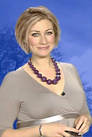 Becky Mantin wearing the Tulip Maternity Dress (Pale Grey) by Tiffany Rose on ITV Weather