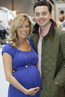 Emma Quinn wearing the Claudia Maternity Gown (Royal Blue) by Tiffany Rose at the Baby Show 2012