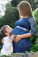 Julia Arshavin wearing the Amelia Maternity Dress (Windsor Blue) by Tiffany Rose, photographed for Hello Magazine