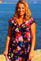 Jasmine Harman wearing the Alessandra Dress Short (Midnight Garden)