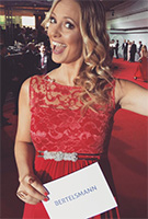 Angela Finger-Erben wearing the Valencia Gown Long (Sunset Red)