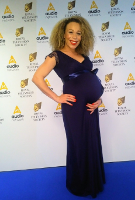 Ria Hebden wearing the Rosa Gown Long (Indigo Blue)