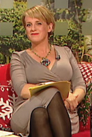 Sybil Mulcahy wearing the Tulip Dress (Pale Grey)