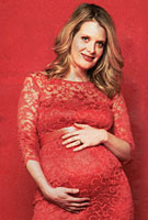 Andrea Lowe wearing the Amelia Maternity Dress (Hot Mandarin) by Tiffany Rose for Celebs on Sunday Photoshoot