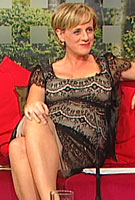 Sybil Mulcahy wearing the Flutter Dress Short (Black)