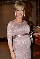Sybil Mulcahy wearing the Amelia Dress Long (Vintage Rose)
