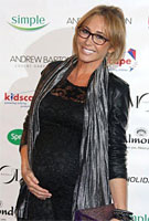 Jenny Frost wearing the Amelia Dress Short (Black)