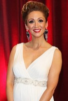Lucy-Jo Hudson wearing the Anastasia Gown Long (Ivory) with Diamante Sash